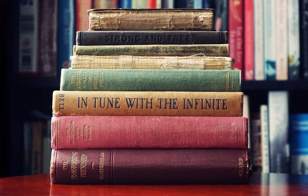Stack of books that contain surprising lessons about life and the universe